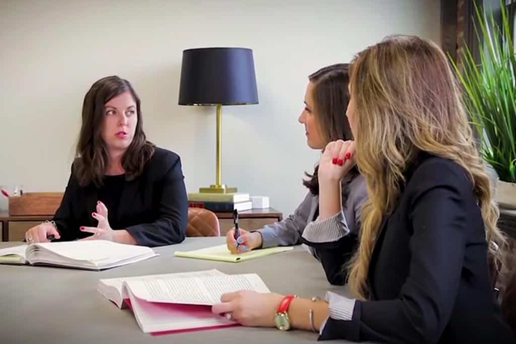 Three female attorneys talking about a divorce case and working hard on it